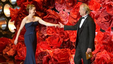 """Amy Adams greets Bill Murray on stage. While reading the names of those nominated for best achievement in cinematography, Murray also mentioned director <a href=""""http://www.cnn.com/2014/02/24/showbiz/movies/obit-harold-ramis/index.html"""">Harold Ramis</a>, his """"Ghostbusters"""" co-star who died last month at the age of 69."""
