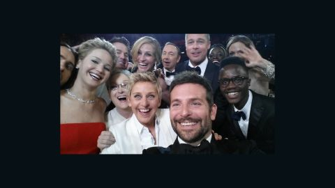 """Academy Awards host Ellen DeGeneres takes a moment during the show to orchestrate a selfie with a group of stars. Bradley Cooper, seen in the foreground, was holding the phone at the time. """"If only Bradley's arm was longer,"""" <a href=""""https://twitter.com/TheEllenShow/status/440322224407314432"""" target=""""_blank"""" target=""""_blank"""">DeGeneres tweeted</a>. """"Best photo ever."""" It reportedly became the most retweeted post of all time."""