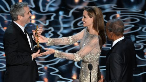 """Angelina Jolie and Sidney Poitier present Alfonso Cuaron with the best director Oscar for """"Gravity."""""""