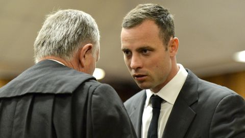 Oscar Pistorius confers with his attorney, Barry Roux, at the Pretoria High Court on March 3, 2014, in Pretoria, South Africa.
