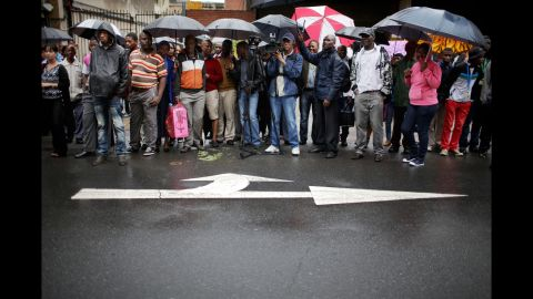 People try to get a glimpse of Pistorius as he leaves the court building on March 3.