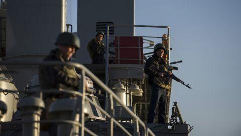 Ukrainian seamen stand guard on the Ukrainian navy ship Slavutych in the Sevastopol harbor on Monday, March 3.