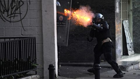 A National Guard member shoots tear gas during protests in Caracas on March 3.