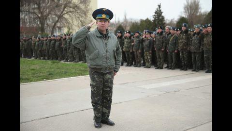 Yuli Mamchun, the commander of the Ukrainian military garrison at the Belbek air base near Sevastopol, salutes on March 4.