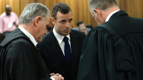 Oscar Pistorius (C) confers with his lawyers on the second day of his murder trial at the North Gauteng High Court in Pretoria, South Africa, on March 4, 2014.