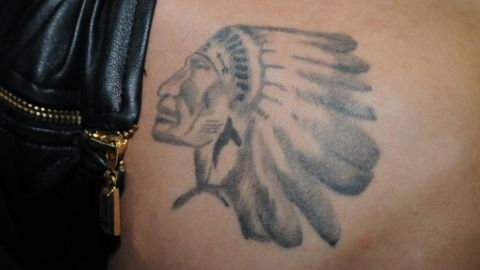 """<a href=""""http://hollywoodlife.com/2013/01/06/justin-bieber-indian-head-tattoo-pic/"""" target=""""_blank"""" target=""""_blank"""">Bieber reportedly tweeted """"This is for u Grampa</a>"""" when he unveiled this tattoo of a Native American in head dress in January 2013. It is believed to be the logo of a Canadian junior ice hockey team whose games the singer's grandfather would take him to."""