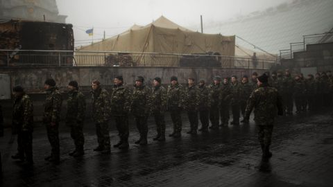Ukrainian military recruits line up to receive instructions in Kiev's Independence Square on Tuesday, March 4.