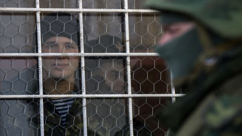 A sailor looks out a window near the entrance to the Ukrainian navy headquarters in Sevastopol on March 3.