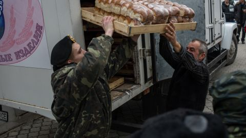 A soldier and a truck driver unload bread outside the Ukranian navy headquarters in Sevastopol on March 2.