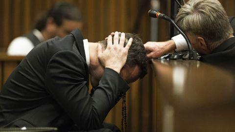 Pistorius covers his ears on Thursday, March 6, as a witness speaks about the morning Steenkamp was killed.