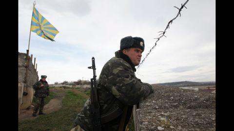 Ukrainian troops guard the Belbek air base on March 6.