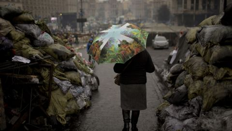 A woman walks past barricades March 6 that were set up by anti-government protesters in Kiev's Independence Square.
