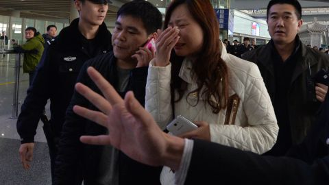A woman believed to be the relative of a passenger onboard Malaysia Airlines flight MH370 cries at the airport in Beijing on Saturday, March 8.