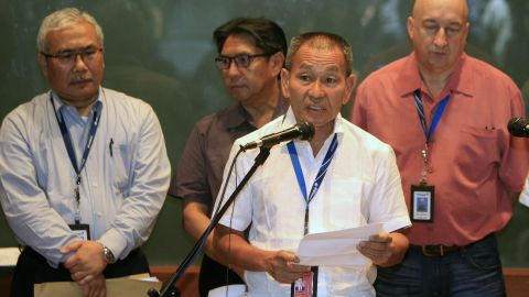 """Malaysia Airlines Group CEO Ahmad Juahari Yahya, front, speaks during a news conference at a hotel in Sepang on March 8, 2014. """"We deeply regret that we have lost all contacts"""" with the jet, he said."""