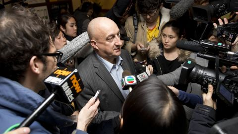 Hugh Dunleavy,  commercial director of Malaysia Airlines,  speaks to the journalists at a hotel where relatives or friends of passengers aboard the missing airplane stay, in Beijing, China Sunday, March 9, 2014. An international fleet of planes and ships scouted the waters between Malaysia and Vietnam for any clues to the fate of the Malaysian Airlines Boeing 777, which disappeared less than an hour after taking off from Kuala Lumpur bound for Beijing on Saturday, March 8. (AP Photo/Andy Wong)