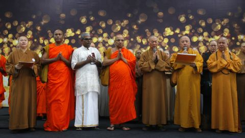 Buddhist monks at Kuala Lumpur International Airport offer a special prayer for the missing passengers on March 9, 2014.