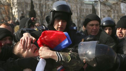 Ukrainian police detain a demonstrator during a pro-Russian rally in Donetsk on March 9.