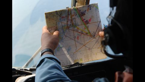 A member of the Vietnamese air force checks a map while searching for the missing plane on March 11, 2014.