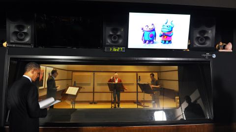 """Obama watches actors Steve Martin, center, and Jim Parsons, on the set of the movie """"Home"""" while touring DreamWorks Animation in November 2013. The President was there to speak about the economy but did make a joke about his ears being the inspiration for the DreamWorks animated film """"Shrek."""""""
