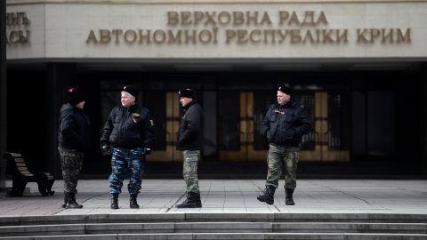Cossacks stand guard at Crimea's regional parliament building in Simferopol on March 12.