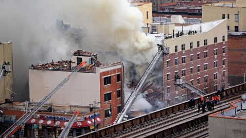NEW YORK, NY - MARCH 12:  Firefighters from the Fire Department of New York (FDNY) respond to a five-alarm fire and building collapse at 1646 Park Ave in the Harlem neighborhood of Manhattan March 12, 2014 in New York City. Reports of an explosion were heard before the collapse of two multiple-dwelling buildings that left at least 17 injured.  (Photo by Justin Heiman/Getty Images)