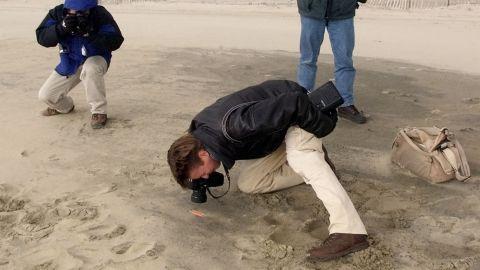 Journalists photograph possible EgyptAir Flight 990 debris in Nantucket, Massachusetts, in November 1999.