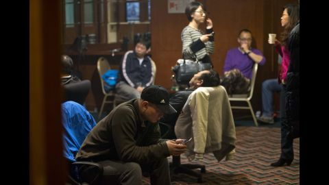 Relatives of missing passengers wait for the latest news at a hotel in Beijing on March 12, 2014.