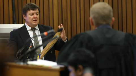 Forensic investigator Johannes Vermeulen, left, is questioned during the trial March 13.