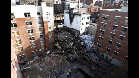 Rubble is seen Friday, March 14, 2014,  two days after a natural gas explosion leveled two apartment buildings in New York, Friday, March 14, 2014. Using sound devices to probe for voices and telescopic cameras to peer into small spaces, workers searching a pile of rubble from a gas explosion in the East Harlem section of Manhattan, continued to treat it as a rescue operation, holding onto the possibility of finding survivors from a blast that brought down two apartment buildings and killed at least eight people. (AP Photo/Julio Cortez)