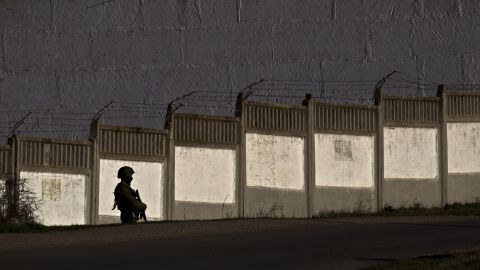 A pro-Russian soldier guards the perimeter outside an Ukrainian military base in Perevalne on March 15.