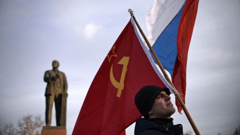 A Crimean man holds a Soviet Union flag in Lenin Square in Simferopol, Ukraine, on March 16.