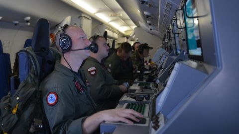 U.S. Navy crew members assist in search-and-rescue operations in the Indian Ocean on March 16, 2014.