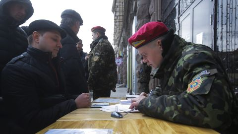 A Ukrainian man applies for the National Guard at a mobile recruitment center in Kiev on March 17.