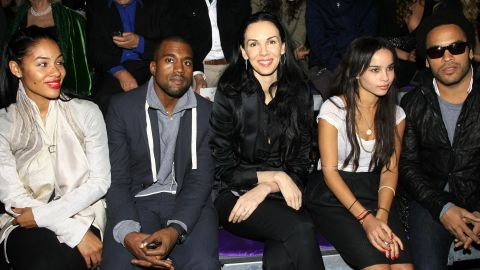 Scott attends the Yves Saint Laurent Fashion Show in Paris with musicians Kanye West, second from left, and Lenny Kravitz, far right, in October 2006.