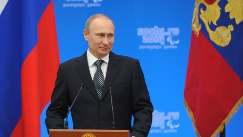 Russia's President Vladimir Putin attends an awarding ceremony for Russian athletes, winners of the XI Paralympic Olympic games, in Sochi on March 17, 2014.