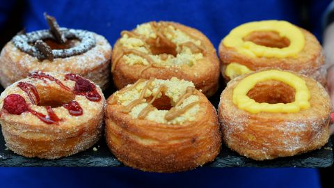 """The fried, cream-filled, croissant-doughnut hybrid known as the Cronut is so popular <a href=""""http://money.cnn.com/2013/07/02/smallbusiness/cronut-controversy/index.html"""">it has its own trademark</a>. Stories of customers lining up outside the Dominique Ansel Bakery in New York before dawn to purchase the pastry (limit two per customer) have become part of its legend."""
