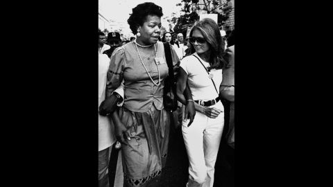 """Steinem walks with writer Maya Angelou on their way to the March on Washington on August 27, 1983. The event commemorated the 20th anniversary of Martin Luther King Jr.'s """"I Have a Dream"""" speech."""