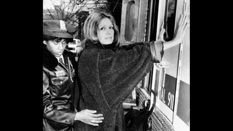 A police officer arrests Steinem in 1984 during an anti-apartheid protest outside the South African Embassy in Washington.