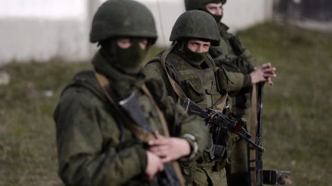 Armed men, believed to be Russian servicemen, stand guard outside a Ukrainian military base in Perevalnoye in Crimea on March 16, 2014.