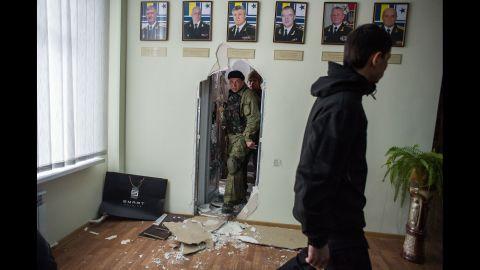 Pro-Russian forces walk inside the Ukrainian navy headquarters in Sevastopol on March 19.