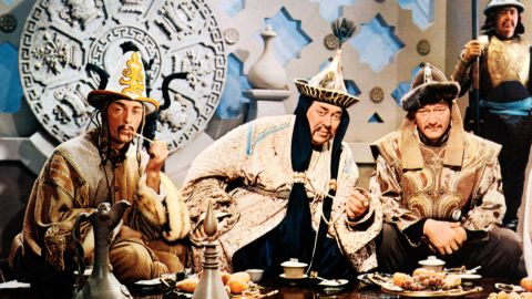 """John Wayne, at right with John Hoyt and Thomas Gomez, played Genghis Khan in """"The Conqueror"""" in 1956."""