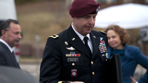 """FORT BRAGG, NC - MARCH 17:  Brig. Gen. Jeffrey Sinclair (C) leaves the Fort Bragg Courthouse with attorneys Ellen Brotman, (R) and Richard Scheff after sexual assault charges against Sinclair were dropped after he plead to lesser charges March 17, 2014 in Fort Bragg, North Carolina. Sinclair, a former deputy commander with the 82nd Airborne Division, has admitted to an extramarital affair with a junior officer. """"Unlawful command influence"""" caused a delay in the trial last week. (Photo by Davis Turner/Getty Images)"""