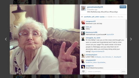"""Grandma Betty flashes a peace sign while sporting """"duck face."""""""