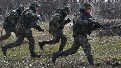 Ukrainian border guards run during training at a military camp in Alekseyevka, Ukraine, on March 21.