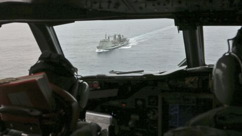 Flight Lt. Jason Nichols, on board a Royal Australian Air Force AP-3C Orion, looks towards HMAS Success as they search for signs of the missing plane on March 22.