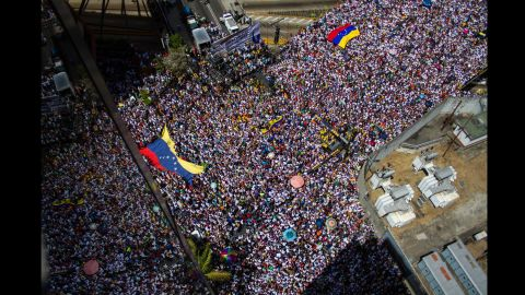 """Thousands fill the streets of Caracas on Saturday, March 22, during an anti-government protest. Meanwhile, a crowd of pro-government students marched against what they called """"fascist violence."""""""
