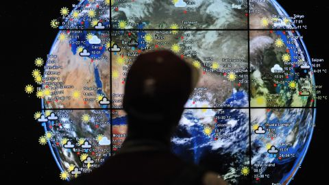 A passenger views a weather map in the departures terminal of Kuala Lumpur International Airport in Kuala Lumpur, Malaysia, on march 22. The search for missing Malaysia Airlines flight MH370 is entering its third week with no clear indication of the fate of the aircraft. Search efforts are focused on the Indian Ocean with reports of satellites capturing images of large floating debris.