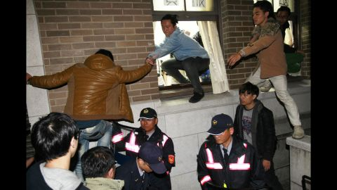 Protesters storm government buildings in Taipei on March 24.