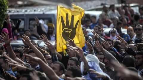 Muslim Brotherhood and ousted President Mohamed Morsi supporters shout slogans during during a demonstration in Cairo on November 29, 2013.
