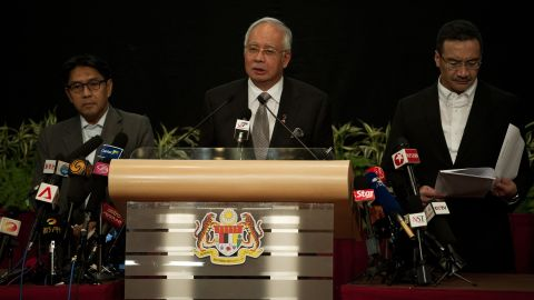 """Malaysian Prime Minister Najib Razak, center, delivers a statement about the flight on March 24, 2014. Razak's announcement came after the airline sent a text message to relatives saying it """"deeply regrets that we have to assume beyond any reasonable doubt that MH 370 has been lost and that none of those onboard survived."""""""
